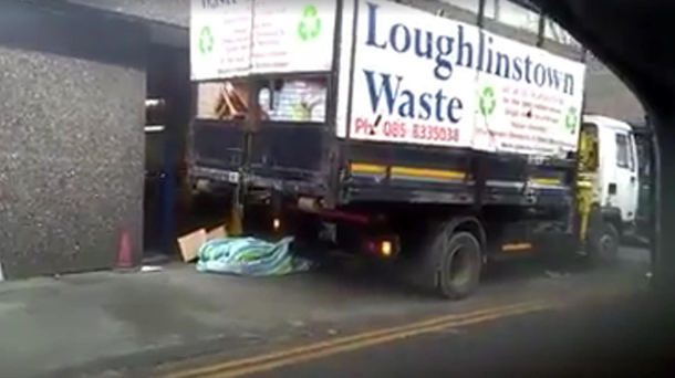The waste truck shown in the video