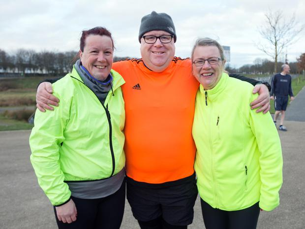 Jennifer Walsh, Ray Corcoran, and Debora McArdle, take part in the Park Run in Poppintree Park, Ballymun