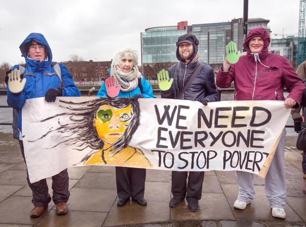 Maureen O'Sullivan TD takes part with anti poverty activists in the Stop Poverty Call to Action event at the Human rights and Poverty Stone on Custom House Quay