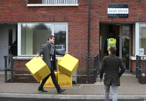 A Savills auctioneer pictured outside show-house in Baldoyle