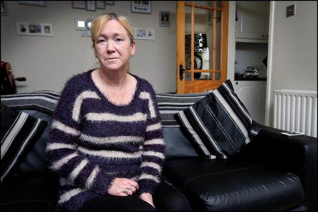 Angelina Byrne from Buttercup Park Darndale in her front room
