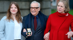Film director Martin Scorsese with his wife Helen Morris and daughter Francesca, holds a gold medal awarded to him by students of Trinity College