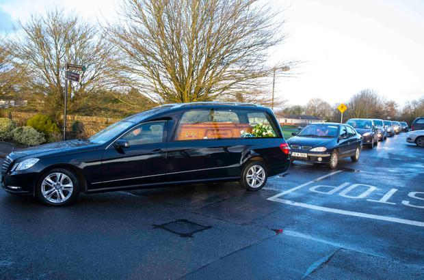 The body of Paddy Lyons is taken from Lismore to Ballysaggart ahead of today's funeral