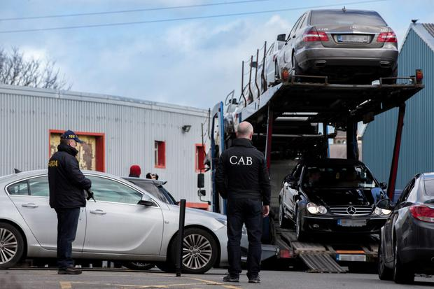 Gardai and CAB officials seizing some of the top-of-the-range cars in Dublin last March