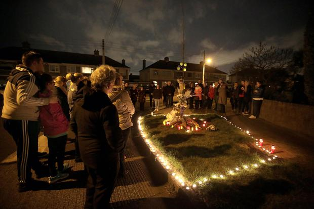 The vigil at the site of the hit-and-run that killed Karl Robertson. Photo: Gerry Mooney