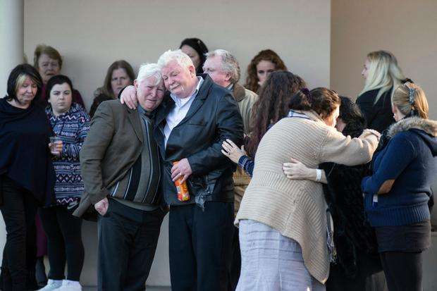 Holly and Jordan's grandparents, John and Bridie O'Brien, are consoled at the funeral home