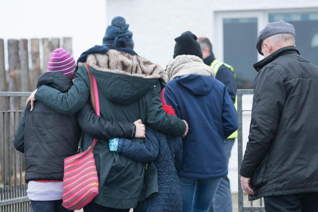 Devastated relatives of the crew gather at Blacksod in Mayo yesterday