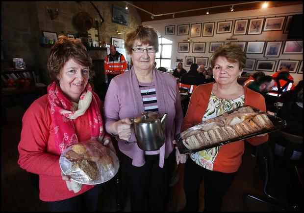 Seosaimh McGintí , Maire Uí Ruadhain and Mary Mallon who are helping out at Blacksod Heritage Centre providing food and tea for emergency services and people involved in the search for Rescue 116