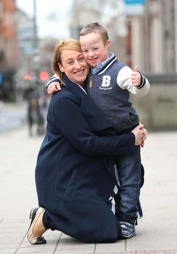 Joanne Duffy from Moyvane, Co. Kerry pictured with her son Ronan, age 6, pictured outside Leinster House highlighting the fact that thousands of children with Down Syndrome are being denied their right to communicate and develop their skills