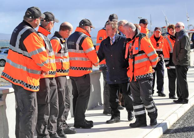 Taoiseach, Enda Kenny pictured with members of the Coastguard involved in the search for Rescue 116