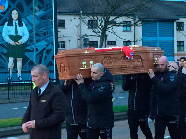 Ryan McBride's coffin is carried from a funeral home in the centre of Derry to his house in the Brandywell area. Photo: PA