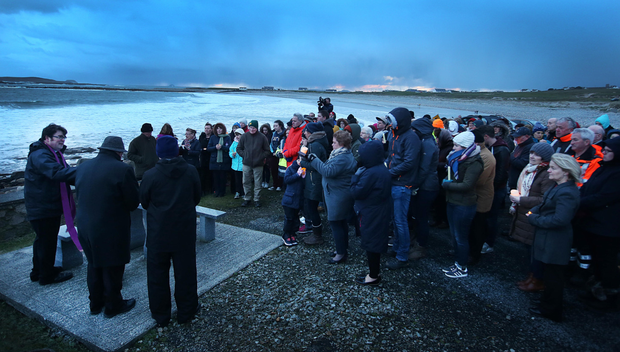 Locals, family and friends of the crew hold a vigil