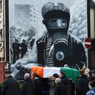 Martin McGuinness' coffin is carried through Derry. REUTERS/Clodagh Kilcoyne