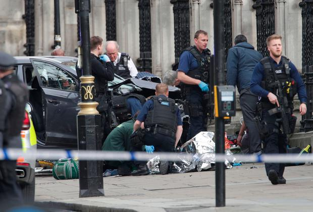 Police close to the Palace of Westminster as they deal with the aftermath of the attack. Photo: PA