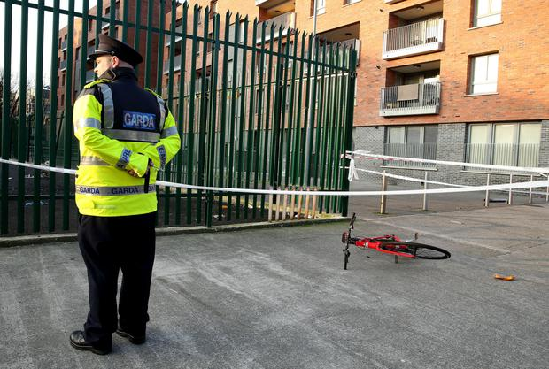 A garda at the scene where Eddie Staunton was knocked off his bike by a car before he was later shot while receiving first aid