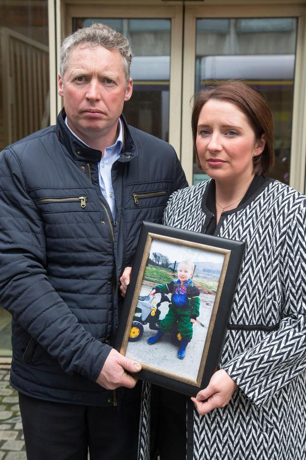 John and Briget Kennedy with a photograph of their deceased son Ronan (3) at The Dublin City Coronor's Court today