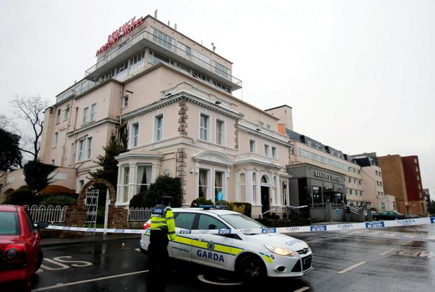 Gardai at the Regency Hotel after last year's shooting. Photo: PA