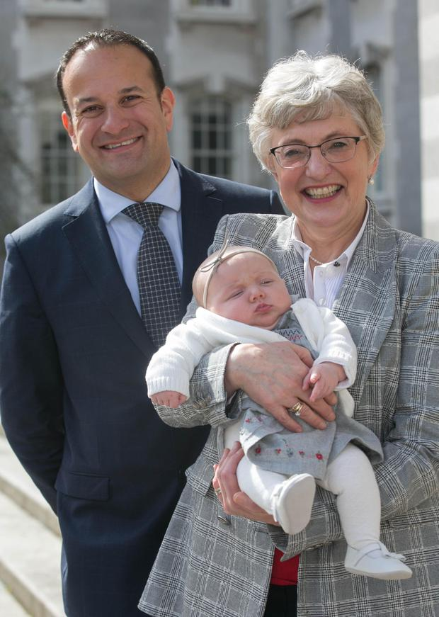 Ministers Leo Varadkar and Katherine Zappone with baby Phoebe Waters during a briefing on the childcare subsidy