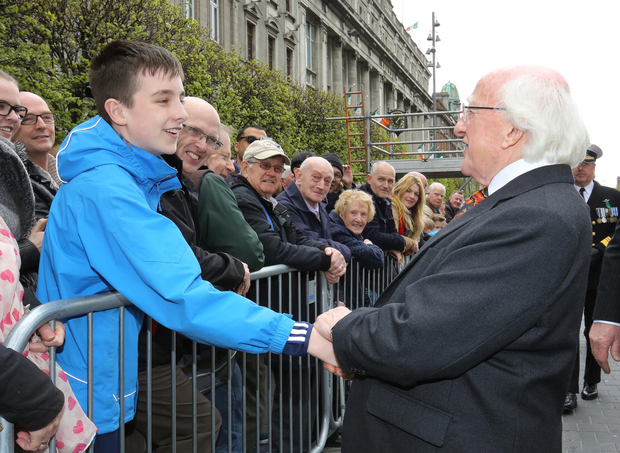 President Michael D Higgins chats with Evan O Máirtín from Beaumount