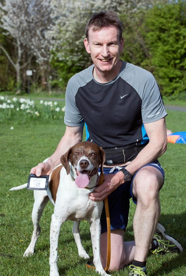 Alan Matthews, who completed his 50th parkrun, and his dog Sheba
