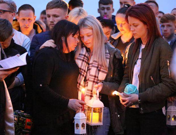 Family, friends and residents of Glenshane estate attend the vigil for Stephen Lynch