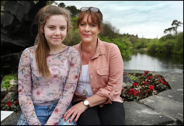 Aoife Ferry (12) from Strabane Co Tyrone with her mum Ann Marie Ferry in Cong Village in Co Mayo ahead of the Rory McIlroy wedding to Erica Stoll this weekend