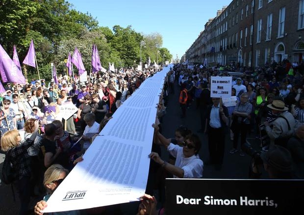 Protesters in Dublin with a 103,607-name petition