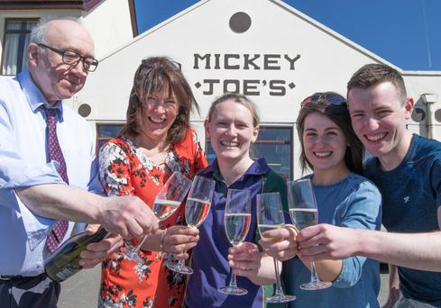 Staff celebrate at Mickey Joe's in Umlagh where one of the winning tickets was sold