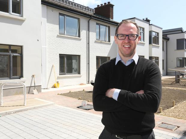Francis Doherty, of the Peter McVerry Trust, outside the modern and energy-efficient homes at St Agatha's Court. Photo: Damien Eagers