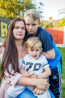 Cheryl Barnewell and her young sons Clayton and Rocco. Photo: Arthur Carron