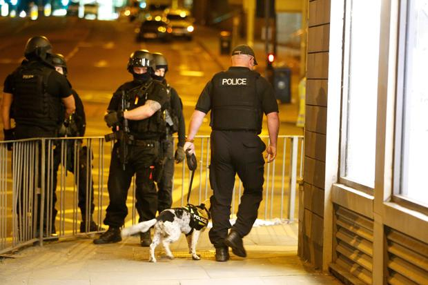 Police after the blast in Manchester. Photo: Reuters