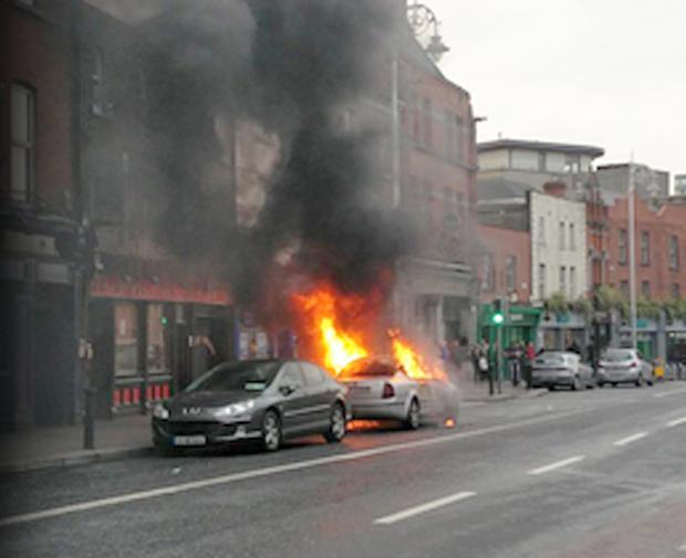 One of the cars targeted burns in the city