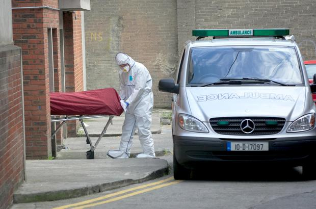 The body of Michael Keogh is taken away