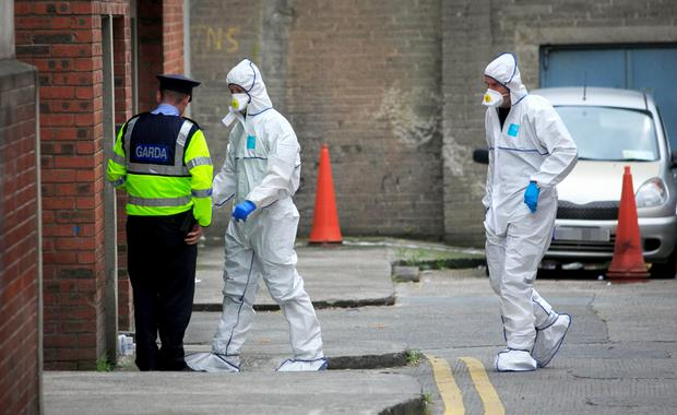 Members of the Garda Technical Bureau at the scene of Michael Keogh's murder in an underground car park in Dorset Street