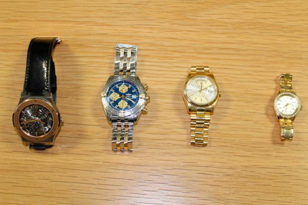 Photo issued by Garda of watches which have been seized along with a pellet gun, 18,000 euro in cash, a car and a van in raids on organised crime gangs.