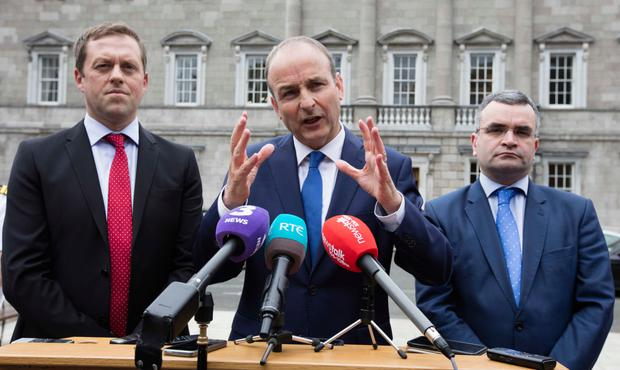Fianna Fail Spokesperson on Education, Thomas Byrne, party leader Micheal Martin and Dara Calleary speak to the media on the Plinth at Leinster House Dublin after meeting the new Leader of Fine Gael and future taoiseach Leo Varadkar