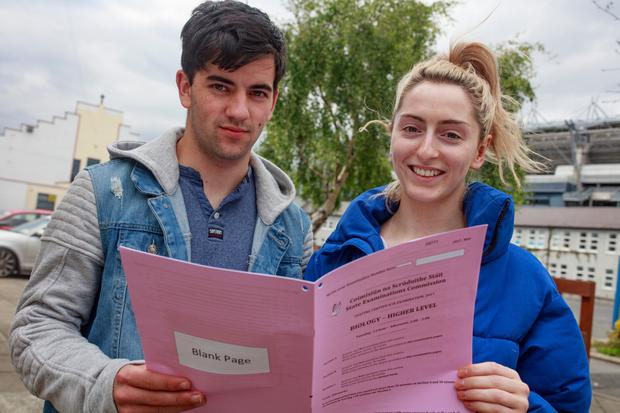 Students Padraig Nash and Louise Whyte after their Leaving Cert biology exam at O'Connell School, Dublin. Photo: Arthur Carron