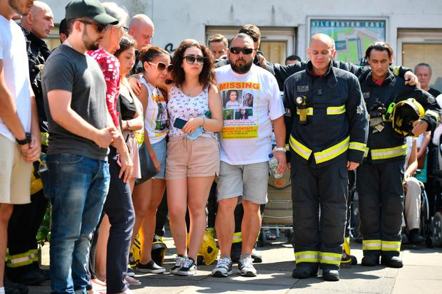 Firefighters join in a minute's silence near Grenfell Tower