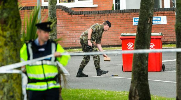 Gardai cordon off the area around Ashington Avenue as army bomb disposal experts deal with the device