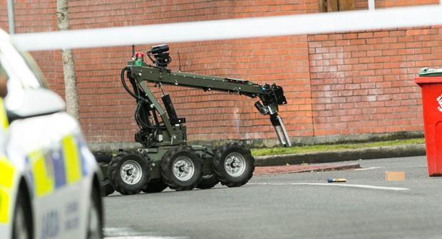 Army bomb disposal experts deal with the device