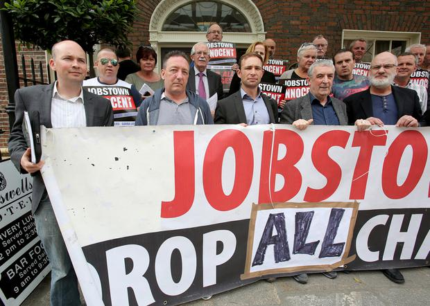 Paul Murphy TD (left) with members of the Jobstown Not Guilty group at the news conference. Photo: Tom Burke