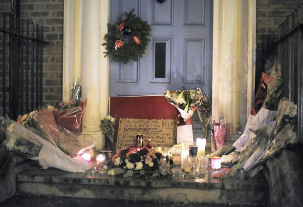 Flowers and cards pictured in the door way where Jonathan Corrie died on Dublins Molesworth Street