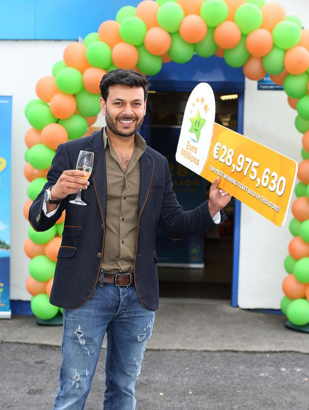 Umesh Kumar, owner of Garyduff Stores, celebrates
