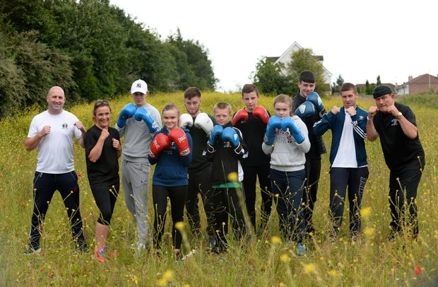 Coach Ed Griffin (left) with members of the Esker Boxing Club on the site of their proposed new clubhouse