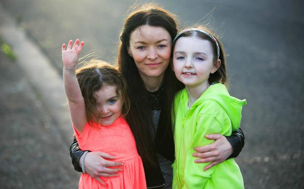 Robyn, on right, with her mum Bernadette and sister Millie
