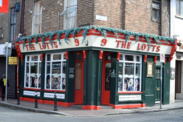 The Lotts Cafe Bar was targeted by raiders where cardboard covers the pane the burglars broke to gain entry