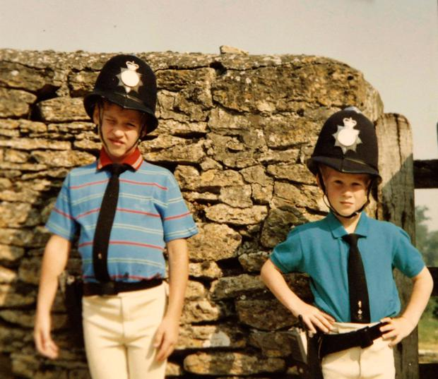 Prince William and Prince Harry in borrowed policemen outfits