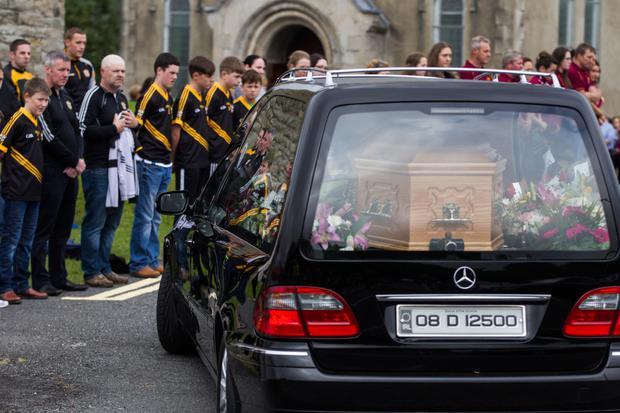The coffins of Margaret McGonigle and her daughter Mairead Mundy are brought for their funeral mass in the Church of Saint Joseph and Saint Conal, Bruckless, Co Donegal