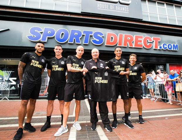 Newcastle United manager Rafael Benitez and five of his players outside the Sports Direct store on North Earl Street