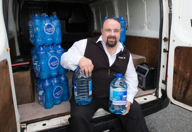 Ray O'Doherty on his rounds delivering water to locals. Photo: Colin O'Riordan